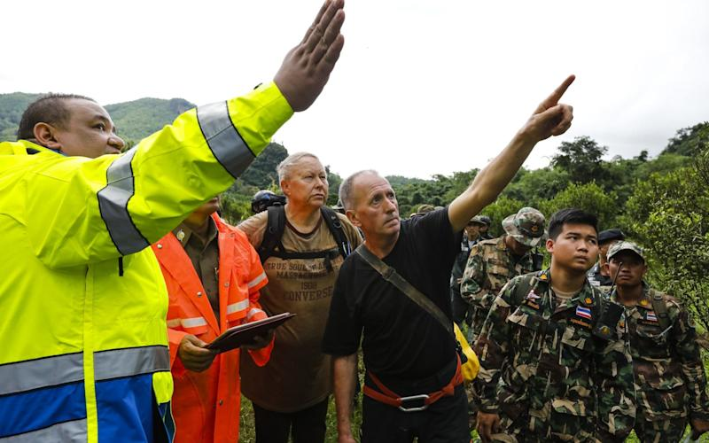British caver Vernon Unsworth, centre, worked with the Thai army and local rescue teams during the daring operation - AFP