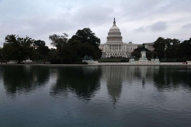 Morning breaks over the U.S. Capitol as the federal government reopens after a 16-day shutdown, in Washington