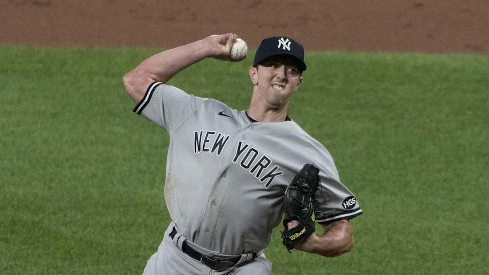 Yankees Brooks Kriske pitches in road uniform