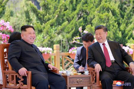North Korean leader Kim Jong Un meets with China's President Xi Jinping, in Dalian, China in this undated photo released on May 9, 2018 by North Korea's Korean Central News Agency (KCNA). KCNA/via REUTERS/Files