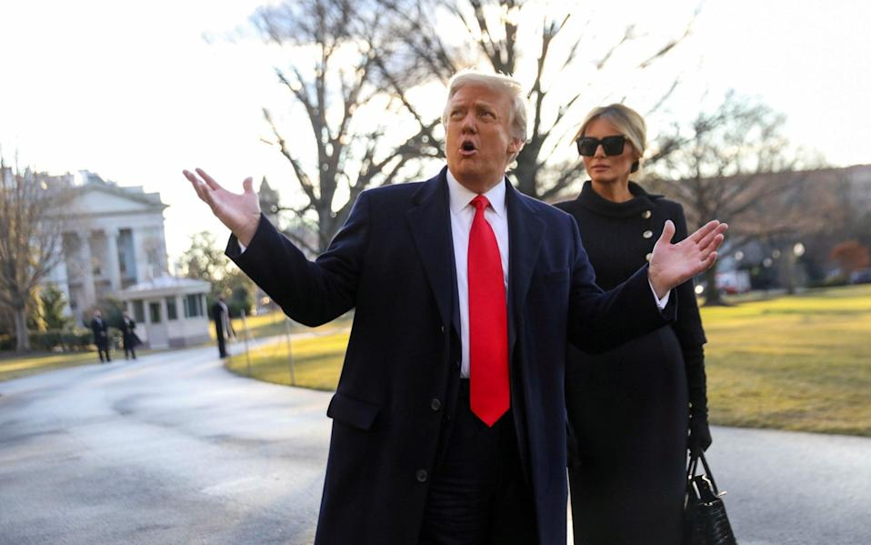 Donald Trump gestures as he and Melania Trump depart the White House  - Reuters