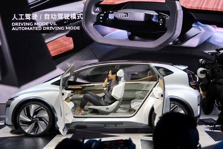 FILE PHOTO: A designer presents an Audi AI:me concept car during an unveiling event in Shanghai, China April 15, 2019.  REUTERS/Norihiko Shirouzu/File Photo