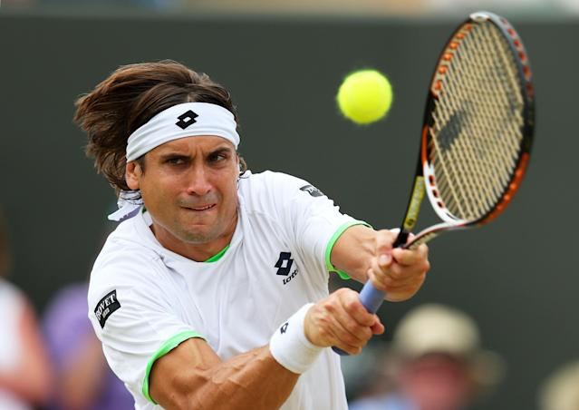 LONDON, ENGLAND - JULY 01: David Ferrer of Spain plays a backhand during the Gentlemen's Singles fourth round match against Ivan Dodig of Croatia on day seven of the Wimbledon Lawn Tennis Championships at the All England Lawn Tennis and Croquet Club on July 1, 2013 in London, England. (Photo by Julian Finney/Getty Images)
