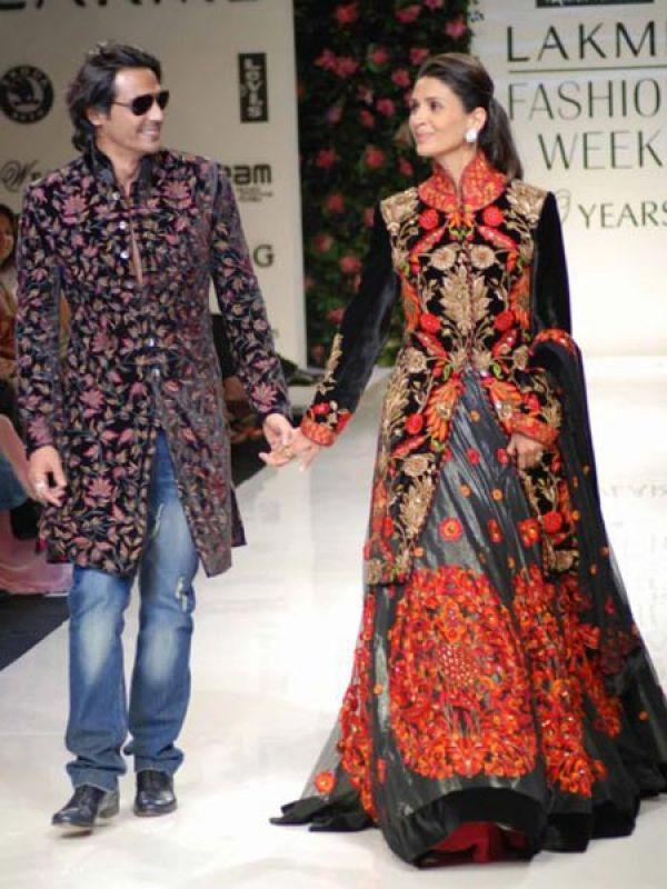 Images via : iDiva.com Arjun Rampal and Mehr Jessia: Former model couple Arjun Rampal and Mehr Jessia walked the ramp together for the Mai Mumbai charity show. The duo donned designs by Rohit Bal and looked lovely together. Related Articles - Bollywood's Best Multi-Starrer Movies Top 5 Bollywood's 'Unseen' Hot Jodis