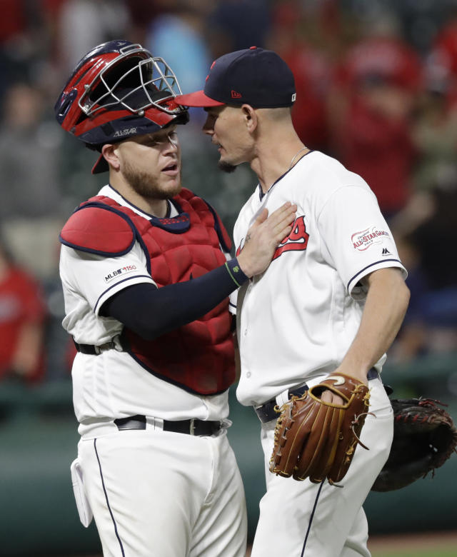 Cleveland Indians' Roberto Perez, left, congratulates relief pitcher Nick Wittgren after the Indians defeated the Chicago White Sox 8-6 in a baseball game Wednesday, Sept. 4, 2019, in Cleveland. (AP Photo/Tony Dejak)