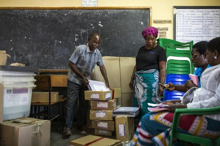 """The court said only 23 percent of the results sheets were verified and it """"finds this to be a serious malpractice that undermined the elections"""" (AFP Photo/PATRICK MEINHARDT)"""