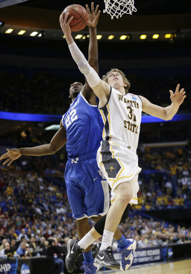 Wichita State guard Ron Baker (31) shoots as Kentucky forward Alex Poythress (22) defends during the first half of a third-round game of the NCAA college basketball tournament Sunday, March 23, 2014, in St. Louis. (AP Photo/Charlie Riedel)