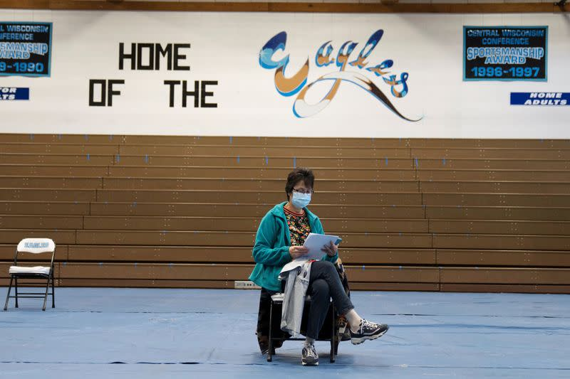 People from rural communities get their coronavirus disease (COVID-19) vaccinations at Menominee Indian High School in Menominee, Wisconsin