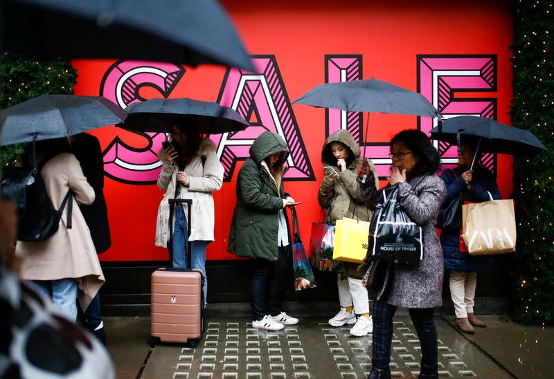 British shops eke out discount driven rise in December sales
