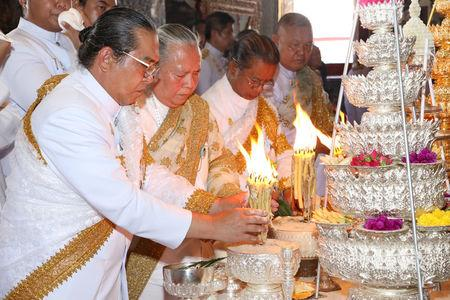 Royal astrologers and members of the Royal Thai court participate in a ritual ahead of the coronation to inscribe Thai King Maha Vajiralongkorn's name and title, cast the king's horoscope, and engrave the king's official seal