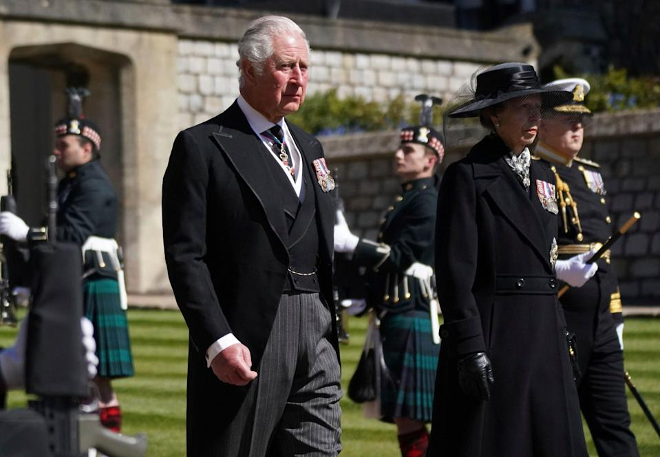 Prince Charles, the Prince of Wales and Princess Anne, the Princess Royal walk in the procession,AP