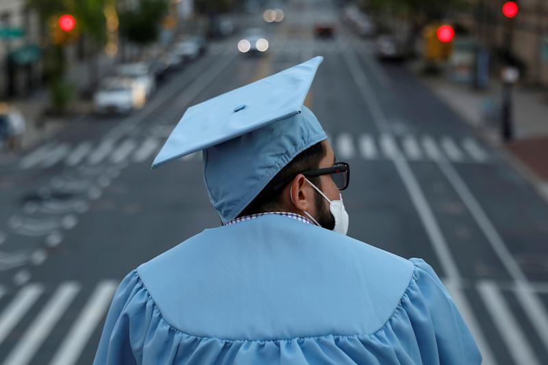 A graduating Masters student from the Columbia University Graduate School of Architecture, Planning and Preservation (GSAPP) stands on campus the day before his graduation ceremony, which is to be held online due to the outbreak of the coronavirus disease (COVID-19) in Manhattan, New York City, U.S., May 15, 2020. REUTERS/Andrew Kelly TPX IMAGES OF THE DAY