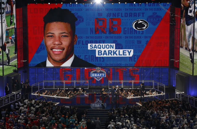 Penn State's Saquon Barkley greets commissioner Roger Goodell on the stage after being selected by the New York Giants during the first round of the NFL football draft, Thursday, April 26, 2018, in Arlington, Texas. (AP Photo/David J. Phillip)
