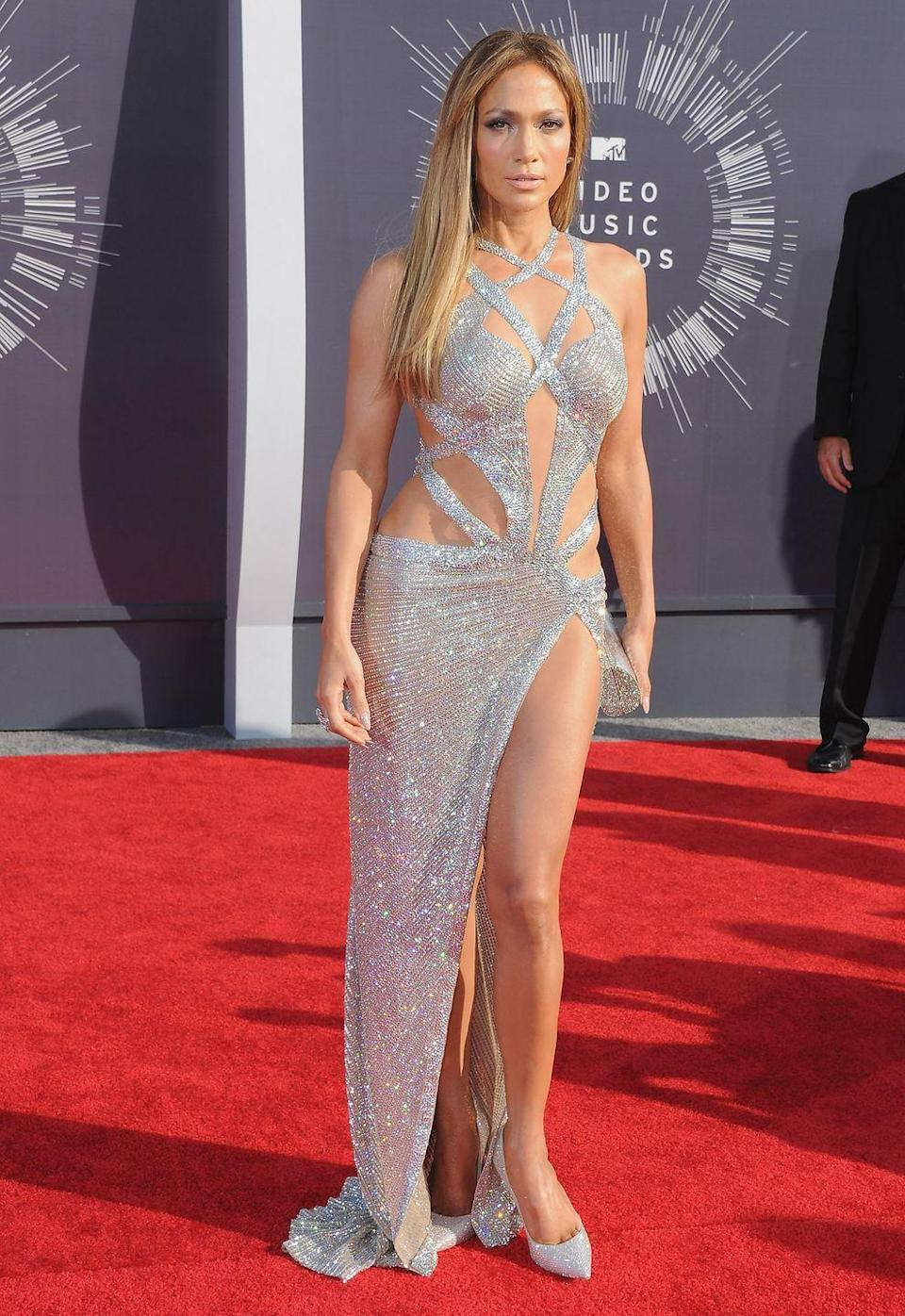 <p>Blinded, once again. J.Lo wears a bedazzled, strappy Charbel Zoe dress at the MTV Video Music Awards, which she pairs with equally glittery heels and clutch.</p>