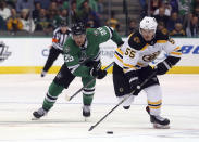 Dallas Stars right wing Brett Ritchie (25) pursued Boston Bruins center Noel Acciari (55) for the puck in the second period of an NHL hockey game Friday, Nov. 16, 2018, in Dallas. (AP Photo/Richard W. Rodriguez)