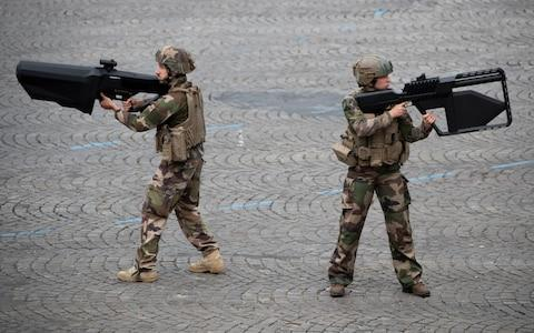 <span>French soldiers demonstrate NEROD F5 anti-drone rifles during the parade </span> <span>Credit: Rex </span>