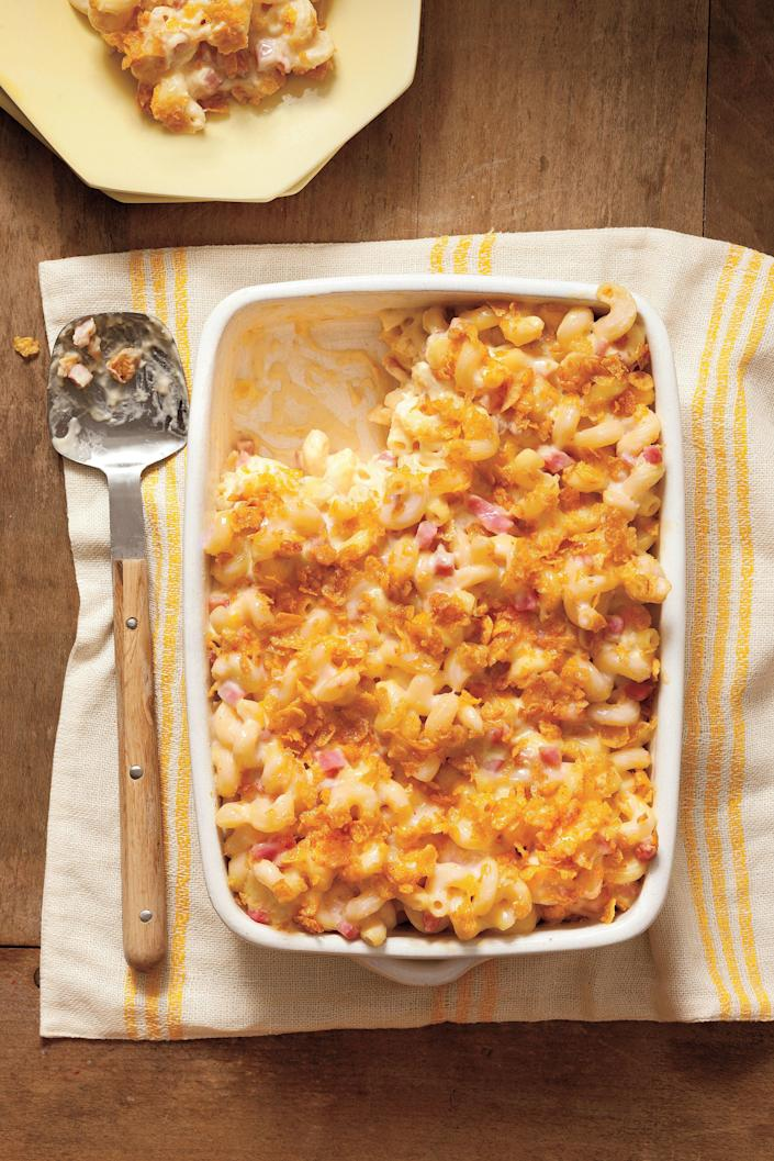 "<p><strong>Recipe: </strong><a href=""https://www.southernliving.com/recipes/mac-cheese-with-ham"" rel=""nofollow noopener"" target=""_blank"" data-ylk=""slk:Mac and Cheese with Ham"" class=""link rapid-noclick-resp"">Mac and Cheese with Ham</a></p> <p>Nobody can resist Grandma's mac and cheese. Even the pickiest of eaters are sure to swoon over this simple casserole. </p>"