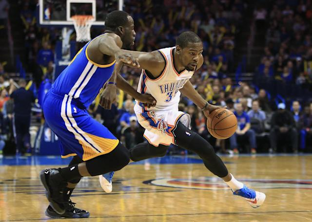 Oklahoma City Thunder small forward Kevin Durant (35) drives to the basket as Golden State Warriors small forward Draymond Green (23) defends during the fourth quarter of an NBA basketball game Friday, Jan. 17, 2014, in Oklahoma City. (AP Photo/Alonzo Adams)