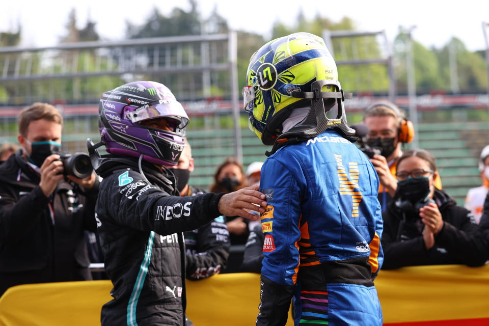 Third placed McLaren's Lando Norris, right, is greeted by second placed Mercedes' Lewis Hamilton at the end of the Emilia Romagna Formula One Grand Prix, at the Imola racetrack, Italy, Sunday, April 18, 2021. (Bryn Lennon/ Pool Via AP)