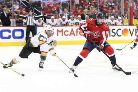 Oct 10, 2018; Washington, DC, USA; Washington Capitals center Evgeny Kuznetsov (92) skates with the puck as Vegas Golden Knights left wing William Carrier (28) defends in the first period at Capital One Arena. Mandatory Credit: Geoff Burke-USA TODAY Sports