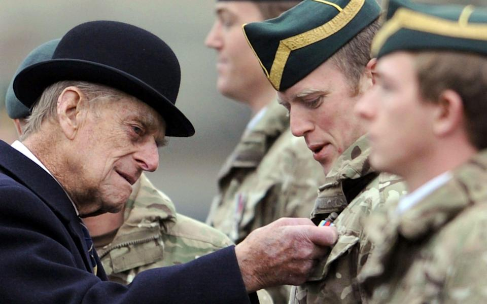 A picture dated shows Britain's Prince Philip, Duke of Edinburgh (L) visiting the tank regiment of the Queen's Royal Hussars in Paderborn, Germany, 19 November 2014 - Shutterstock