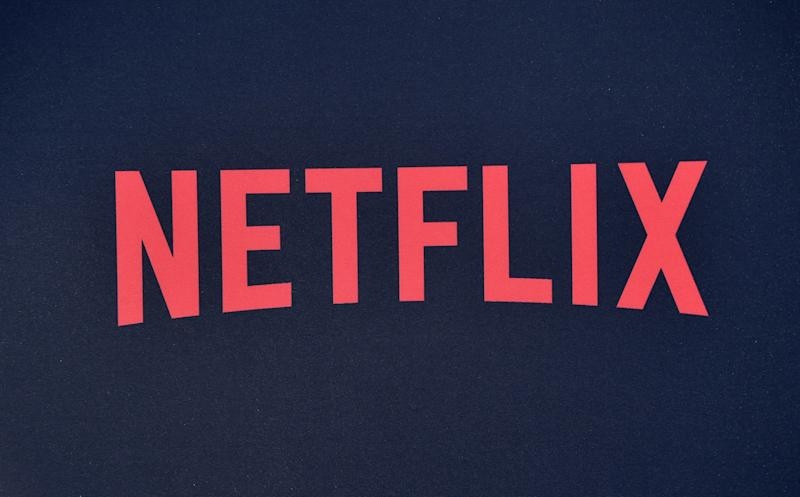 "Netflix logo seen on the backdrop of Netflix's ""Stranger Things 3"" premiere at Santa Monica high school Barnum Hall on June 28, 2019 in Santa Monica, California. (Photo by Chris Delmas / AFP) (Photo credit should read CHRIS DELMAS/AFP/Getty Images)"