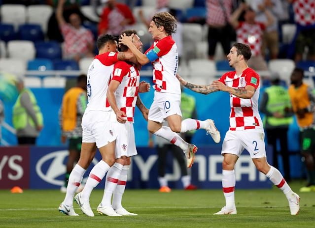 Soccer Football - World Cup - Group D - Croatia vs Nigeria - Kaliningrad Stadium, Kaliningrad, Russia - June 16, 2018 Croatia's Mario Mandzukic celebrates with Luka Modric and team mates after Nigeria's Oghenekaro Etebo scores an own goal and their first REUTERS/Matthew Childs TPX IMAGES OF THE DAY