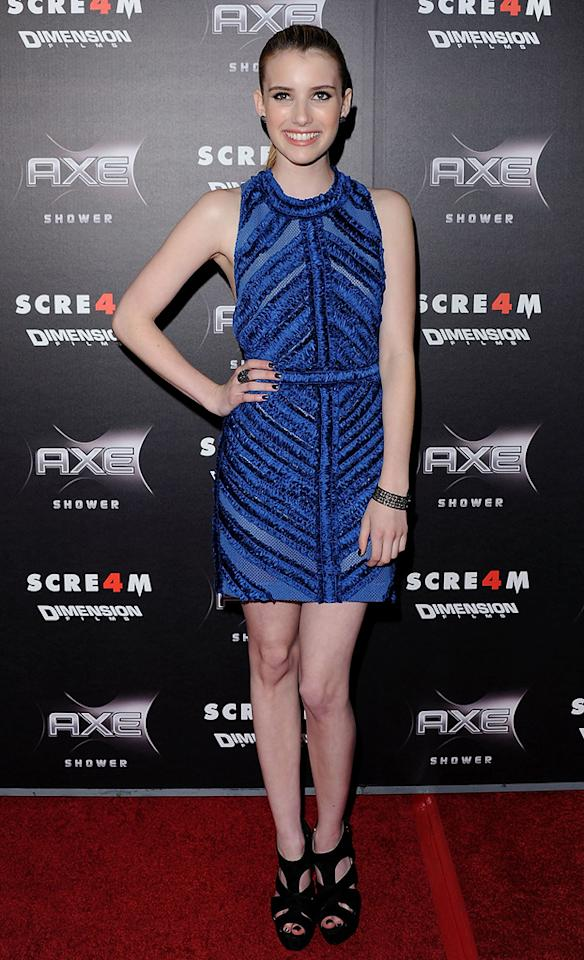 "New ""Scream"" queen <a href=""http://movies.yahoo.com/movie/contributor/1804508466"">Emma Roberts</a> popped a pose in a blue Burberry Prorsum halter dress and chunky Elie Saab heels."