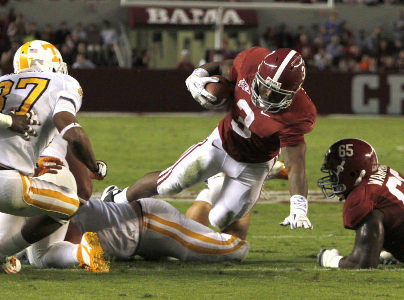 Alabama running back Trent Richardson (3) stretches for extra yardage against Tennessee during the first half of an NCAA college football game on Saturday, Oct. 22, 2011 in Tuscaloosa, Ala.  (AP Photo/Butch Dill)