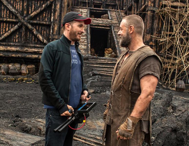 """This image released by Paramount Pictures shows director Darren Aronofsky, left, and actor Russell Crowe on the set of, """"Noah."""" (AP Photo/Paramount Pictures, Niko Tavernise)"""