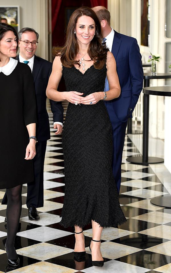 <p>The Duchess of Cambridge stunned in a black Alexander McQueen gown while attending a reception at the British Embassy in Paris. Très chic! (Photo: Pool/Samir Hussein/WireImage) </p>