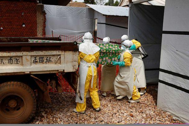 PHOTO: In this file photo, health workers dressed in protective suits place a coffin containing the body of an Ebola patient to a truck at an Ebola treatment centre in Butembo, in the Democratic Republic of Congo, March 26, 2019. (Baz Ratner/Reuters, FILE)