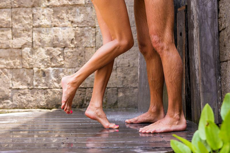 Couple having shower together, concept of sexually close relationship