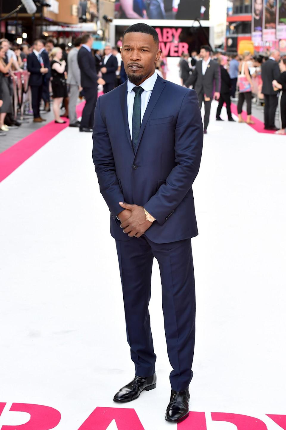 <p>Foxx opted for a blue suit (a popular option for many men in the summer months) and looked as dapper as always. <br><em>[Photo: PA]</em> </p>