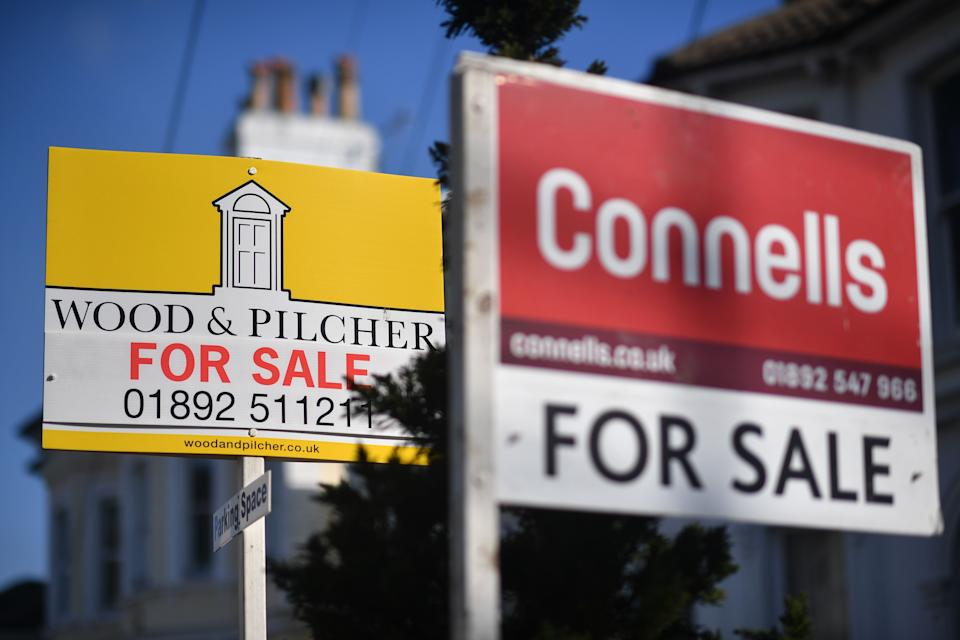 House for sale signs on a residential street in Tunbridge Wells, southeast England. Photo: Ben Stansall/AFP via Getty