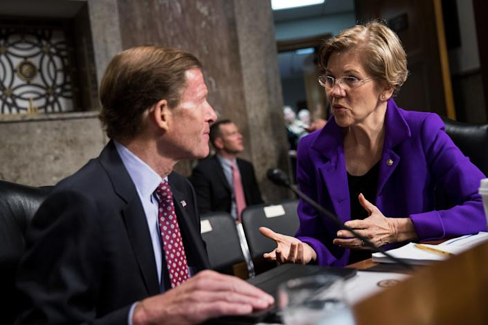 Sen. Richard Blumenthal (D-Conn.) talks with Sen. Elizabeth Warren (D-Mass.) before the start of a Senate Armed Services Committee hearing concerning the roles and responsibilities for defending the nation against cyberattacks, on Oct. 19, 2017.