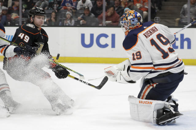 Edmonton Oilers goaltender Mikko Koskinen, right, blocks a shot by Anaheim Ducks left wing Max Jones during the second period of an NHL hockey game in Anaheim, Calif., Sunday, Nov. 10, 2019. (AP Photo/Chris Carlson)