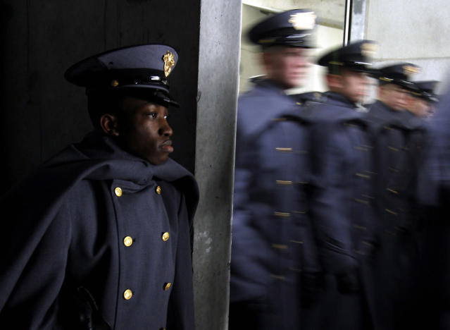 <p>Henry Obie, a student from Nigeria studying at West Point, watches Army cadets march onto the field before an NCAA college football game against Navy at Lincoln Financial Field, Dec. 14, 2013, in Philadelphia. (Photo: Jacqueline Larma/AP) </p>