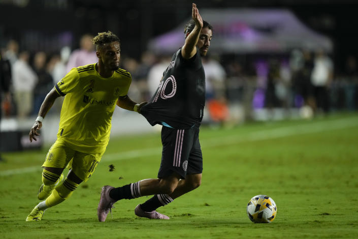 Nashville midfielder Hany Mukhtar left, holds back Inter Miami midfielder Rodolfo Pizarro as he goes for the ball, during the first half of an MLS soccer match, Wednesday, Sept. 22, 2021, in Fort Lauderdale, Fla. (AP Photo/Rebecca Blackwell)