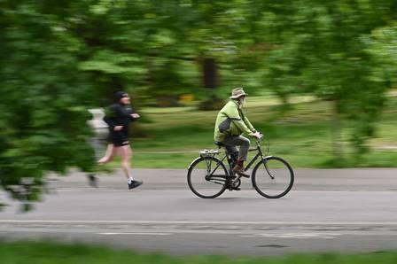 88134504_A cyclist rides a bike through Greenwich park south east London on May 14 2020 following an.jpg