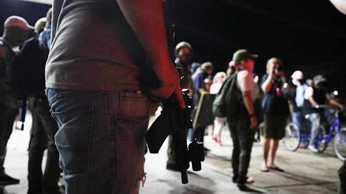 Armed civilians stand in the streets of Kenosha to protect the area against the arson during third day of protests over the shooting of a black man Jacob Blake by police officer in Wisconsin, United States on August 25, 2020. (Tayfun Coskun/Anadolu Agency via Getty Images)