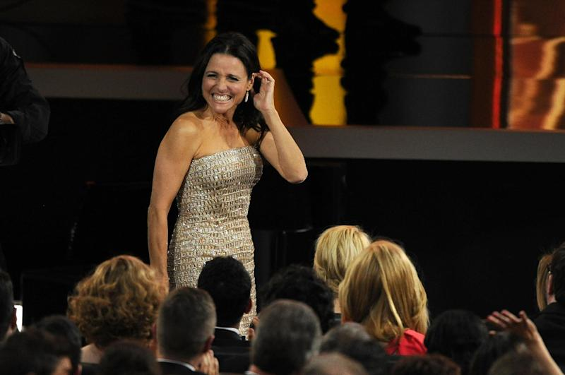 """Julia Louis-Dreyfus reacts as it was announced that she won the award for outstanding lead actress in a comedy series for her role on """"Veep"""" at the 65th Primetime Emmy Awards at Nokia Theatre on Sunday Sept. 22, 2013, in Los Angeles. (Photo by Chris Pizzello/Invision/AP)"""