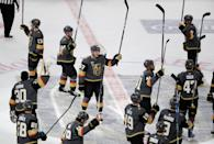 <p>The Golden Knights salute the fans after finishing off the Coyotes 5-2. (John Locher/AP) </p>
