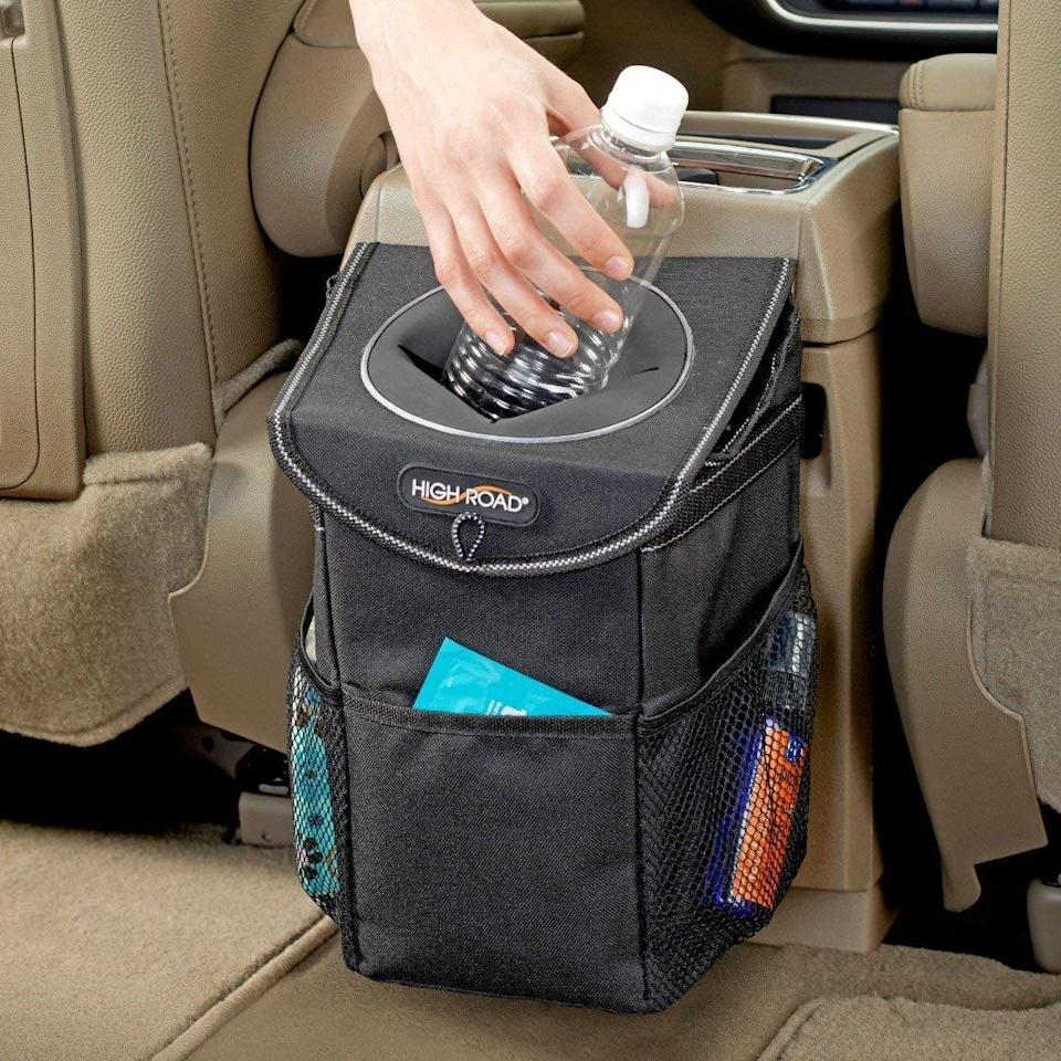 <p>If you don't have this <span>High Road StashAway Car Trash Can With Lid and Storage Pockets</span> ($14), you're missing out.</p>