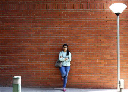 Urvashi Kapila, 19, a college student, poses for a picture at her college campus in New Delhi March 7, 2014. REUTERS/Anindito Mukherjee
