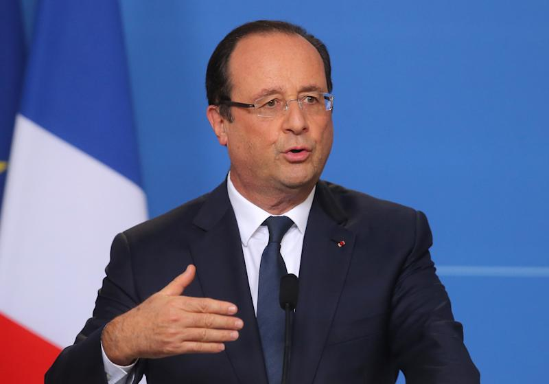 French President Francois Hollande gestures as he speaks to the media during an EU summit, Friday, Oct. 25, 2013. European leaders united in anger as they attended a summit overshadowed by reports of widespread U.S. spying on its allies - allegations German Chancellor Angela Merkel said had shattered trust in the Obama administration and undermined the crucial trans-Atlantic relationship. (AP Photo/Michel Euler)