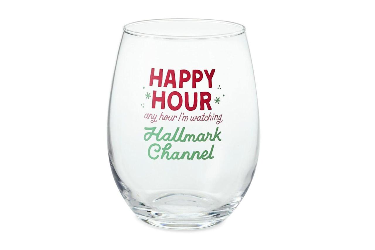"""<p>Settle in for your binge-watching festivities with your favorite beverage.</p> <p><strong>BUY IT: $13;</strong> <a href=""""https://www.hallmark.com/gifts/kitchen/wine-glasses/hallmark-channel-happy-hour-stemless-wine-glass-12-oz.-1HKC1019.html"""" target=""""_blank"""">hallmark.com</a></p>"""