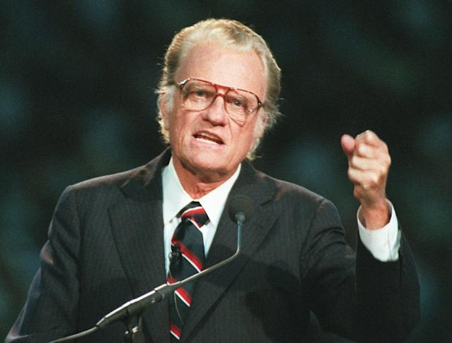 In this Oct. 26, 1994 file photo, Evangelist Billy Graham begins his sermon in Atlanta's Georgia Dome. Spokesman Mark DeMoss says Graham, who long suffered from cancer, pneumonia and other ailments, died at his home in North Carolina on Wednesday, Feb. 21, 2018. He was 99. (AP Photo/John Bazemore)