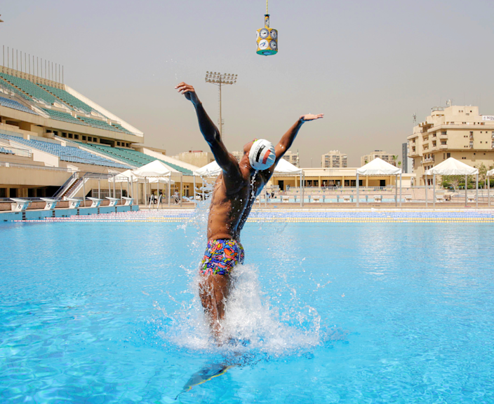Swimmer Omar Sayed Shaaban wearing a monofin training in a pool in Cairo, Egypt - Sunday 21 March 2021