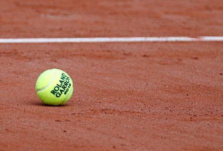 Tennis - French Open - Roland Garros, Paris, France - May 25, 2019. An official ball is seen on the court on the eve of the start of the tournament. REUTERS/Vincent Kessler